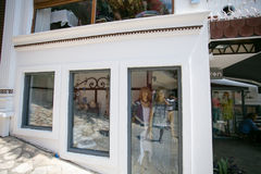 Clothing shop in Kalkan Turkey. KALKAN, TURKEY - MAY 22 Clothing shop in Kalkan resort town of Turkey located in stone house painted white with mannequins Royalty Free Stock Photos