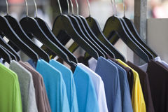 Clothing store. T-shirts in a row Royalty Free Stock Image