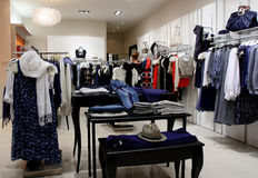 Clothing Store. Fashion clothes shop in malls Stock Photography