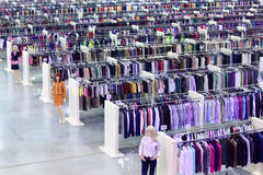 Clothing store, dummies and rows with hangers Stock Images