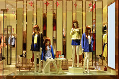 Clothing store and fashion shop window. Interior view of a fashion shop window, Hongkong, China, Asia Stock Images
