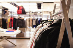 Clothing store. In front hangers with clothes Royalty Free Stock Image