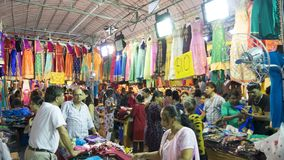 Clothing store at Little India Singapore. Singapore - January 04, 2018: Crowded people buying clothes in clothing store at Little India Singapore Stock Images
