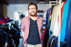 Clothing store. Portrait of male sales assistant in clothing store Stock Photography