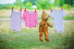 Clothing and a teddybear on a clothesline Royalty Free Stock Photos