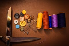 Clothing accessories,thread, scissors and measuring tape. Clothing tools and accessories closeup, scissors, threads and needles royalty free stock photos