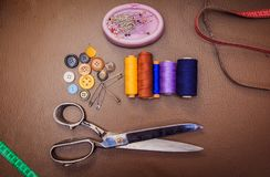 Clothing accessories,thread, scissors and measuring tape. Clothing tools and accessories closeup, scissors, threads and needles stock photos