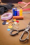 Clothing accessories,thread, scissors and measuring tape. Clothing tools and accessories closeup, scissors, threads and needles royalty free stock image