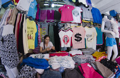 Clothing Vendor at market Stock Images