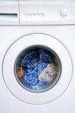 Clothing in washing machine. Colorful clothing in washing machine Royalty Free Stock Photography
