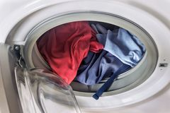 Clothing in washing machine. Concept- laundry, housework, house. Cleaning royalty free stock photos