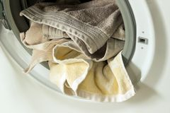 Clothing in washing machine.  Concept- laundry, housework, house. Cleaning Stock Photo