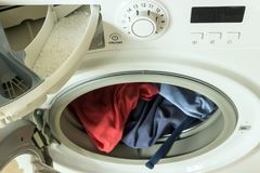 Clothing in washing machine.  Concept- laundry, housework, house. Cleaning Stock Image