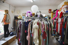 Clothing And Wigs At Second Hand Store Royalty Free Stock Photos