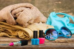 Clothing, women`s accessories and cosmetics. On old wooden background Royalty Free Stock Photography