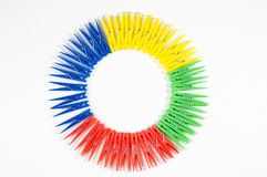 Cloths peg. Multicolored plastic cloths peg in pattern on white stock photography
