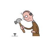 Clou de marteau de vieil homme de personnes Photos libres de droits