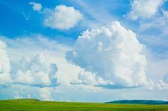 Cloud. The big clouds over a green field stock photos