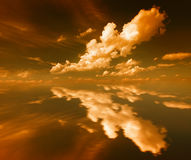 Cloud. Mirror sunset cloud- orange color Stock Photo