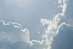 Cloud. On the blue background Royalty Free Stock Photo