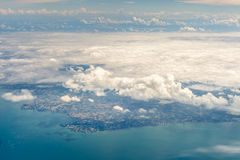 Cloud above island and sea from aerial view Stock Photos
