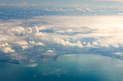 Cloud above island and sea from aerial view Stock Images