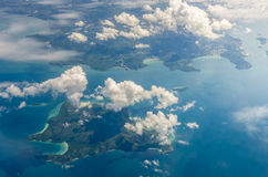 Cloud above island and sea from aerial view Royalty Free Stock Photos