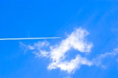 Cloud and Airplane. Nice Clouds and Flying Airplane Stock Photo
