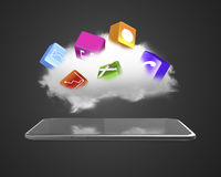 Cloud with app blocks floating above smart tablet Stock Photography