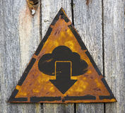 Cloud with Arrow Icon on Rusty Warning Sign. Stock Photo