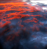 Cloud Background. Wild cloud background from above with red sunlight Royalty Free Stock Image