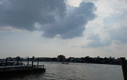 Cloud beyond the river stock photos
