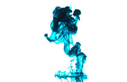 Cloud of blue ink in water isolated. royalty free stock photography