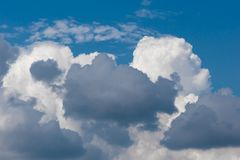 Cloud on blue sky background. Cloud in white and gray color Royalty Free Stock Image