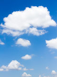Blue sky with clouds. In vertical Stock Image