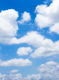 Blue sky with clouds. In vertical Stock Photos