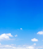 Blue sky with clouds. Vertical royalty free stock photos