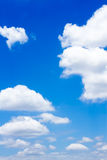 Blue sky with clouds. In vertical shot Stock Photos
