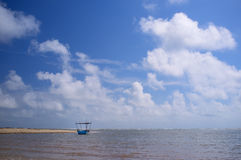 Cloud and a boat. A small boat with clear sky and cloud as background Royalty Free Stock Images
