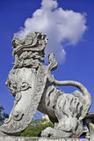 Cloud Breathing Lion. Stone Statue of a Lion breathing a white cloud from its nostrils against a bright blue sky in Chiang Mai, Thailand Stock Photo