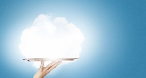 Cloud bubble. Human hand holding metal tray with cloud Stock Photography