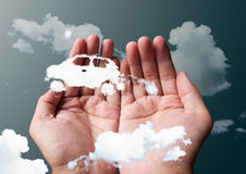 Cloud car. In two hands Royalty Free Stock Photos