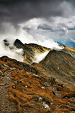 Cloud caress. Fagaras mountains caressed by silky clouds Royalty Free Stock Photos