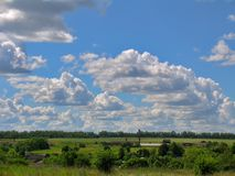 Cloud cascade against the blue sky Royalty Free Stock Photos