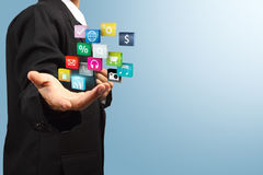 Cloud of colorful application icons in the hands Stock Photo