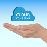 Cloud computing. Female hand with a blue cloud and text cloud computing royalty free stock photos