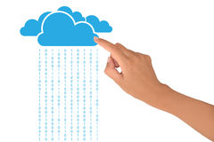 Cloud computing. Concept with female hand pointing at blue clouds with binary code