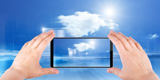 Cloud computing. Technology background, cloud computing, augmented reality, abstract smartphone in hands, multimedia gadget stock photo