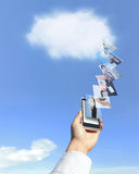 Cloud computing. Hand holding mobile phone with cloud computing stock image