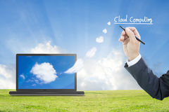 Cloud Computing. Businessman Hand Writing Cloud Computing Concept Royalty Free Stock Photo